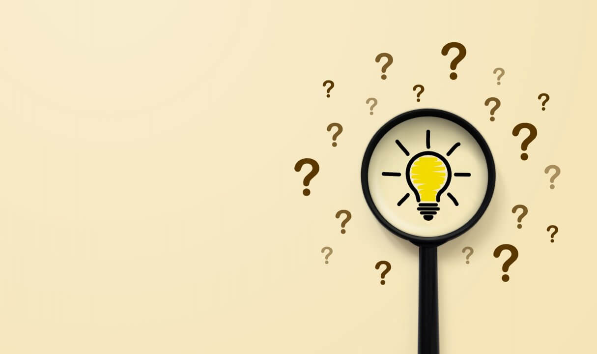 Magnifying glass with light bulb icon and question mark symbol. Concept creative idea and innovation